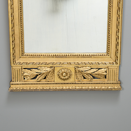 An early 19th century late neoclassical wall mirror.