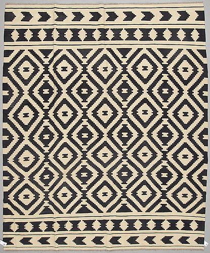 A kilim carpet 312 x 261 cm.