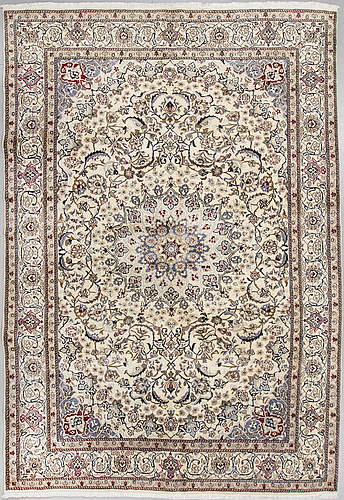 A carpet, nain, part silk, around 340 x 241 cm.