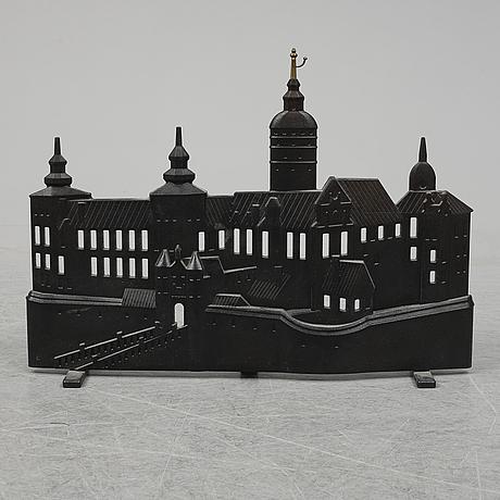 Prins carl philip och eric ericson, eldskärm, cpb 2101, gjutjärn och mässing, för firma svenskt tenn.