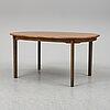 A late 20th century walnut veneered dining table.