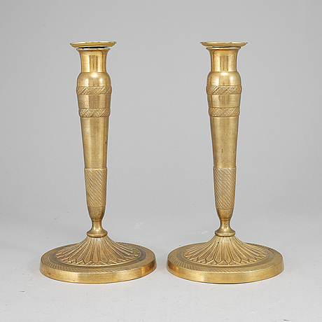 A pair of empire candlesticks, first half of the 19th century.