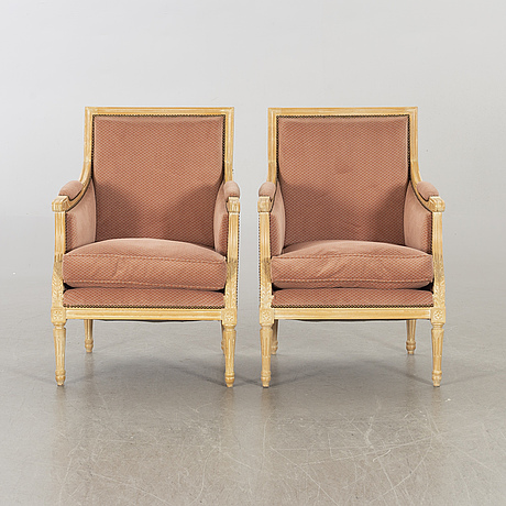 A pair of 20th century gustavian style armchairs.