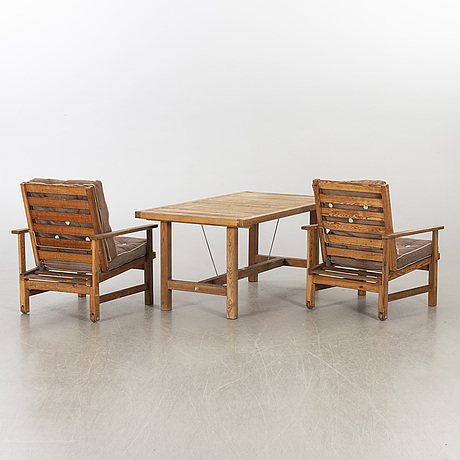 A pair of garden armchairs and a table, elsa stackelberf for fri form.