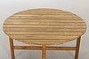 A circular garden table, probably elsa stackelberg for fri form.