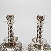 A pair of silver baroquestyle candlesticks. w.h.h, stockholm. 1935. filled foot.
