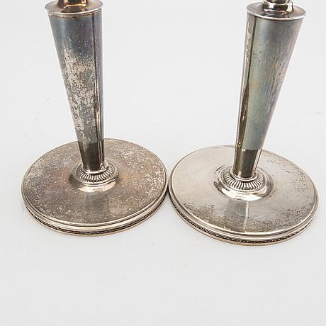 A pair of silver candlesticks. eric råström, stockholm. 1945. total weight 400 gram.