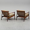 A pair of 'usa 75' teak easy chairs by folke ohlsson for dux.