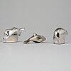 Gunnar cyrÉn, a group of three silver plated figurines, dansk designs, japan.