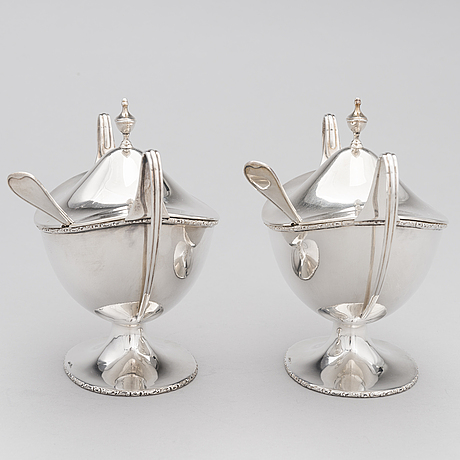 A pair of lidded silver sugar bowls with sprinkle spoons, mark of the firm carl fredrik carlman, stockholm 1928-29.
