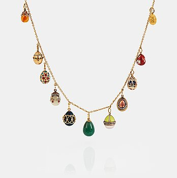 919. A FABERGÉ  GOLD Chain Necklace WITH 8 GOLD, ENAMEL ETC MINIATURE EASTER EGG PENDANTS, S.T PETERSBURG and 3 other.