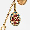 A fabergÉ  gold chain necklace with 8 gold, enamel etc miniature easter egg pendants, s.t petersburg and 3 other.