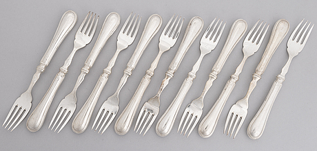 A 24-piece set of fish cutlery in silver, mark of cgh, stockholm 1899. original box.