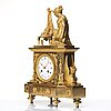A empire early 19th century gilt bronze mantel clock.
