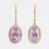 A apir of 18k gold earrings set with faceted kunzites.