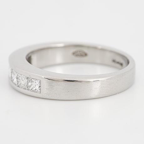 Platinum and six princess-cut diamond ring.