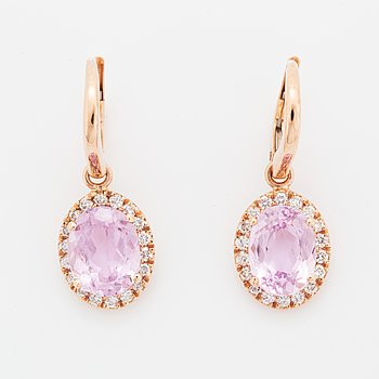 Oval faceted kunzite and brilliant-cut diamond earrings.