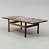 A rosewood and stone coffee table by erling viksjø for conglo design.