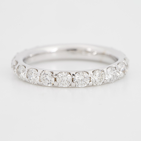 White gold and brilliant-cut diamond ring.