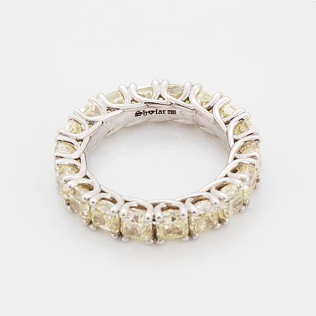 Cuschion-cut diamond eternity ring.