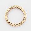 Cushion-cut yellow diamond eternity ring.