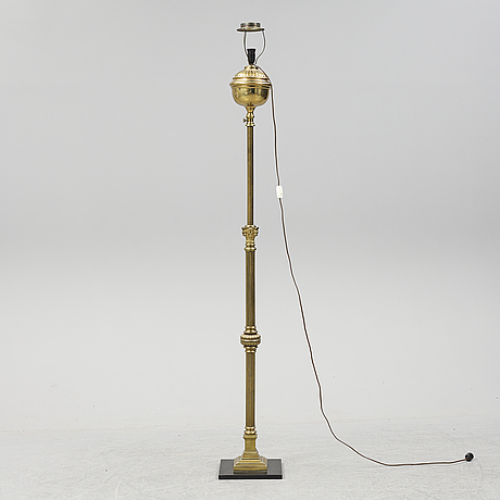 A brass floor lamp, first half of the 20th century.