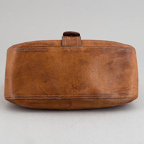 Mulberry, a tan leather bag.