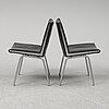 Hans j wegner, a pair of 'ch 401' 'lufthavnstolen' chairs from the kastrup series, denmark, 1960's.