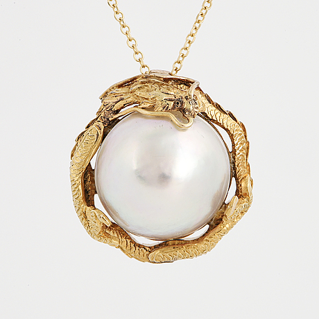 A pearl dragon pendant with chain.