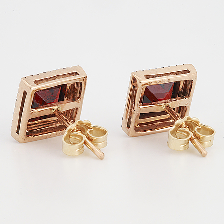 A pair of square earrings with facet cut garnets and brilliant cut diamonds.
