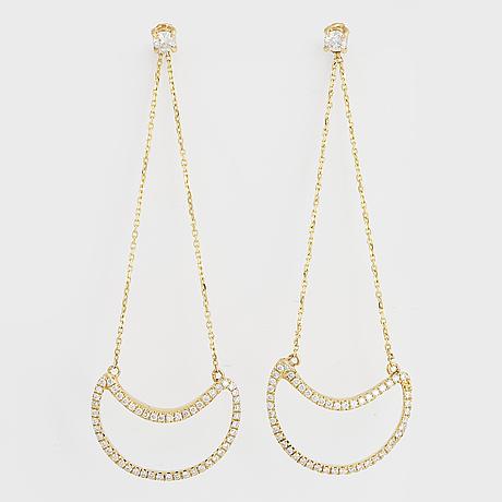 Diamond moon earrings.