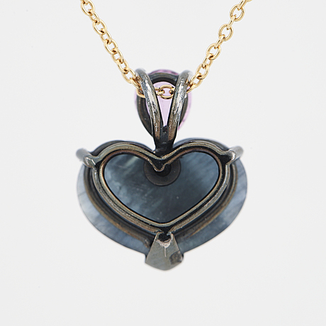 An heart shaped sapphire and pink sapphire pendant.