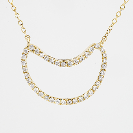 Brilliant-cut diamond moon necklace.