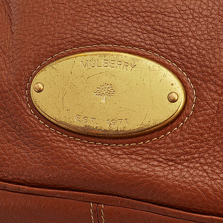 Mulberry, a brown leather handbag.