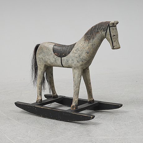 A wooden rocking horse from the early 20th century.