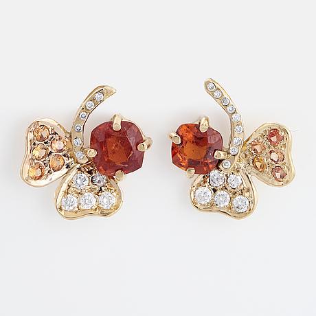 Orange zircon, orange sapphire and brilliant-cut diamond trefoil earrings.