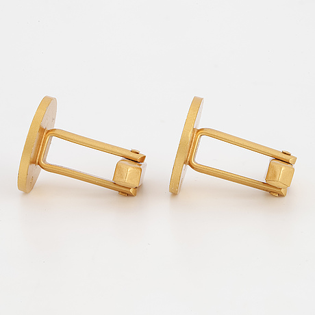 A pair of 18 k gold cuffs, weight ca 16 g.