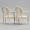 A pair of gustavian armchairs.
