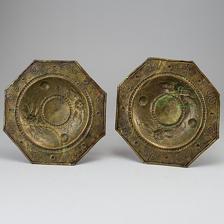 A pair of baroque style candle holders.