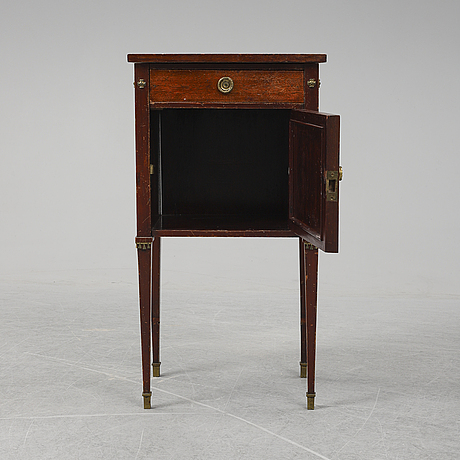 A first half of the 20th century mahogany veneered bedside table.