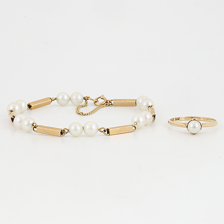 18k gold pearl bracelet and ring.