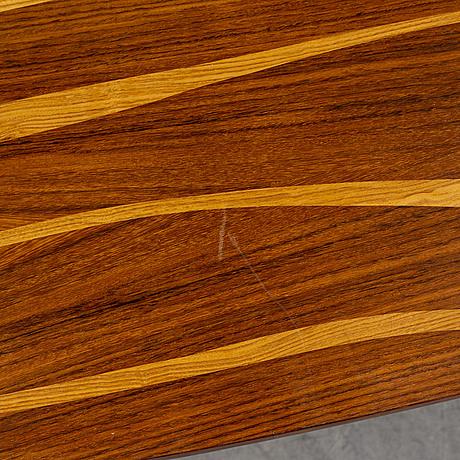 A rosewood veneered 1950's coffee table.