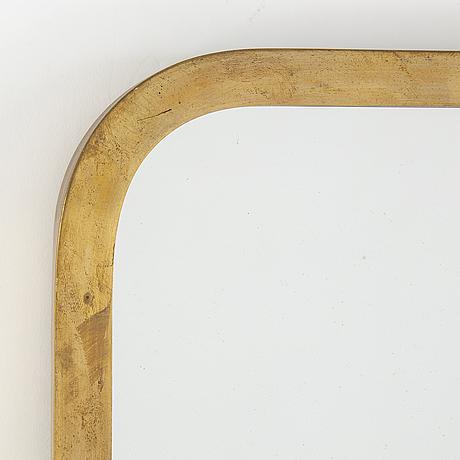 A swedish modern brass mirror with lamp, 1940's.
