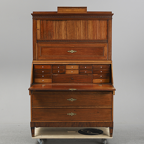 A late gustavian mahogany veneered writing cabinet, first half of the 19th century.