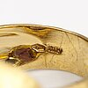 An 18k gold ring with an amethyst. italy, import marked rubens, helsinki 1997.