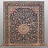 A carpet, kashmar, signed, ca 390 x 295 cm.