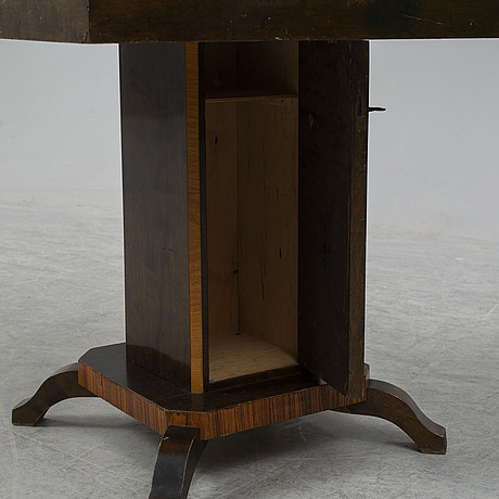 A art déco sofa table with bar cabinet.