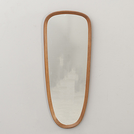A wall mirror  swedish modern.