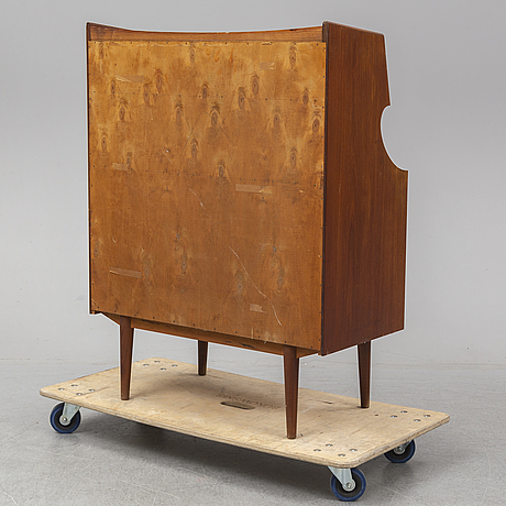 A teak veneered chest of drawers, second half of the 20th century.