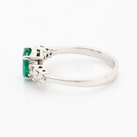 Oval emerald and brilliant-cut diamond ring.